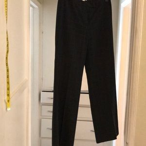 Designer gray pants with large cubicle patterns.